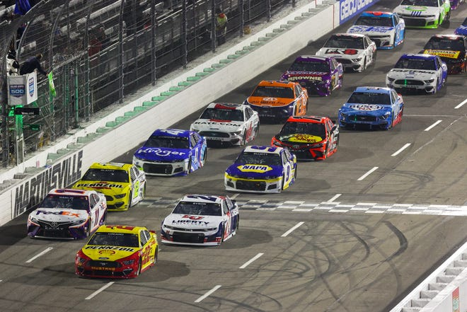 Apr 10, 2021; Martinsville, Virginia, USA; NASCAR Cup Series drivers cross the start line during the Blue-Emu Maximum Pain Relief 500 at Martinsville Speedway. Mandatory Credit: Ryan Hunt-USA TODAY Sports