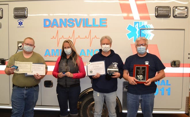 From left, Andy Patterson, Tanya Tatu, Len Saluzzo and Floyd Sick honored at the Dansville Ambulance annual Banquet and Awards Ceremony.
