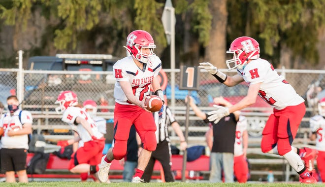 Hornell's Dom Nasca hands the ball off during last week's contest against Dansville. The Red Raiders look to get another win over Attica this week in Maple City Park.