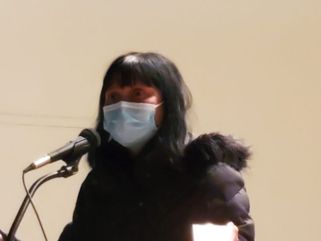 The Rev. Sandra Pontoh thanked people who came out Sunday night, April 11, 2021, to Henry Law Park in Dover for supporting Asian communities. The event was hed after the killings in Georgia last month of eight people, including six Asian women.