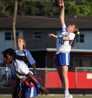 Stanton's Charlee Evoniuk (10) leaps to grab the ball one-handed in a high school girls flag football game against Parker on April 5, 2021. [Clayton Freeman/Florida Times-Union]