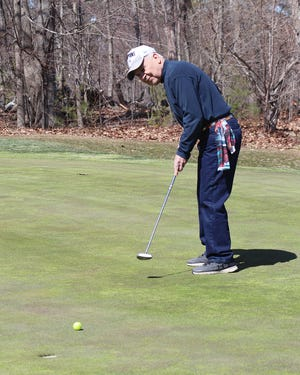 Brian Szoc hones his putting stroke on the practice putting green at Gardner Municipal Golf Course as the course opened for the 2021 season last week.