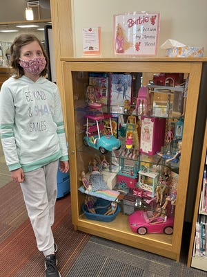 Annie Reed's collection of Barbie items are on display at the Geneseo Library.