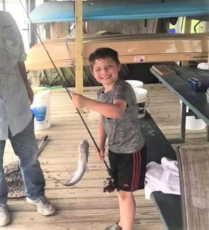 Seth Neal visited the pier recently to participate in the catfish round-up taking place on the Diversion.