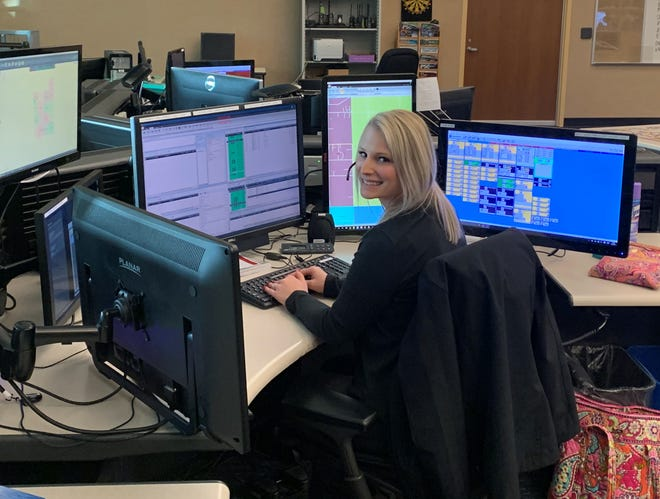 Dispatcher Katelyn Brower at her desk at Ottawa County Central Dispatch.