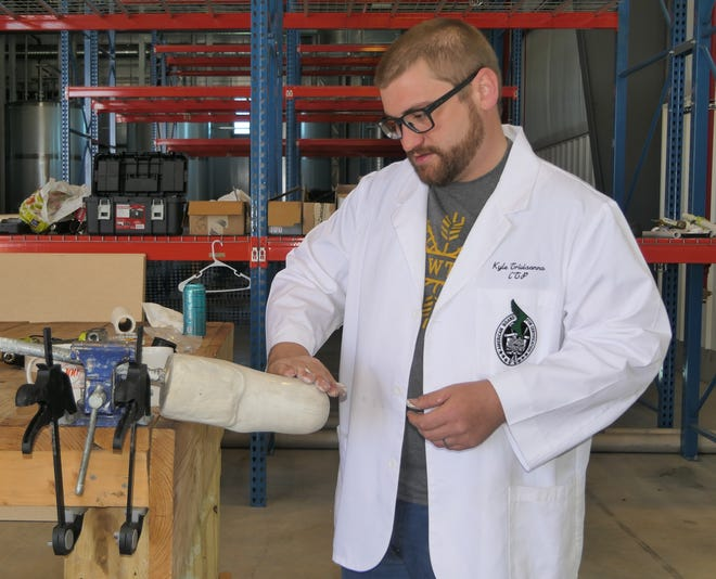 Kyle Trivisonno works on a prosthetic made out of industrial hemp fiber at Human Plant Solutions, a start-up manufacturing company located in Newton, Kansas.