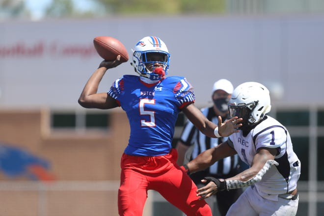 Hutchinson quarterback CJ Ogbonna rushes out of the pocket in the Blue Dragons' game against Arkansas Baptist Sunday. The Blue Dragons beat the Buffaloes 48-8.