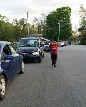 The demand for food in the community is still high and by 6 a.m. cars began to line up on Dewitt Street for the recent food drive held at 2586 Onslow Drive in Jacksonville hosted by Mt. Carmel Helps.