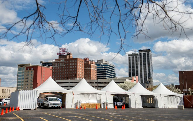 Two bays for drivers and one for walkups are available at the temporary COVID-19 testing facility in the Peoria Civic Center parking lot in Downtown Peoria. Local public health officials announced on Wednesday, June 23, 2021, that the site would permanently close at the end of the day.