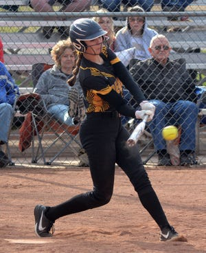 Newton softball player Gracie Rains swings at a pitch during play against Maize South.