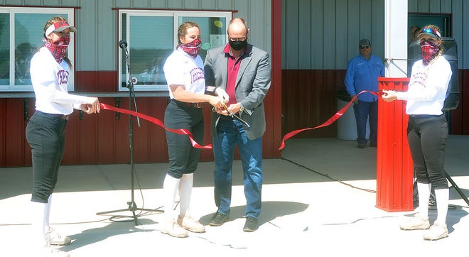 Bethel College Jon Gering and player Emalee Overbay cut the ribbon Saturday during the dedication ceremony for the BC softball clubhouse, along with a new press box and lighting system at Allen Wedel Field.