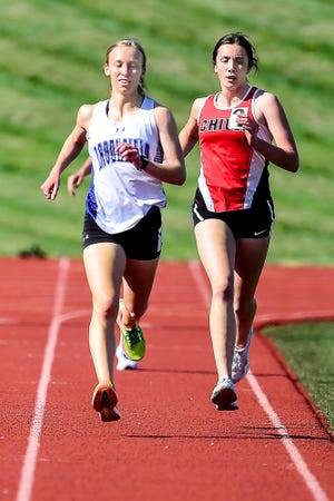Junior Alexandra Sharp of Brookfield High School heads up the front straightaway of the Jerry Litton Memorial Stadium II track a stride or so ahead of Chillicothe freshman Jolie Bonderer during the 1,600-meters run in last Friday's Chillicothe Joe Shy Relays track-and-field meet. Sharp won the 1,600, 800 and 3,200 and placed sixth in the 400 to amass 33 team points, second-most by an individual in the girls' division of the 15-schools meet.