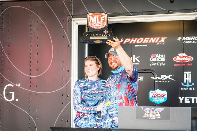 Camdenton angler Andy Newcomb celebrates his win at a Major League Fishing event on Grand Lake in Oklahoma.