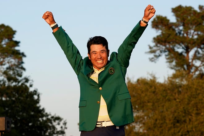 Hideki Matsuyama, of Japan, celebrates after putting on the champion's green jacket after winning the Masters golf tournament on Sunday, April 11, 2021, in Augusta, Ga.