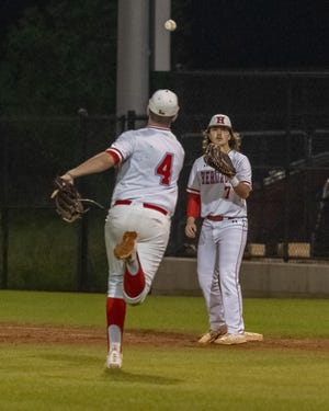 Heritage pitcher Briley Green throws to first baseman Kaden Sayles for a putout during Friday's District 11-4A home game against Ferris. The Jaguars defeated the Yellowjackets in six innings, 15-5.