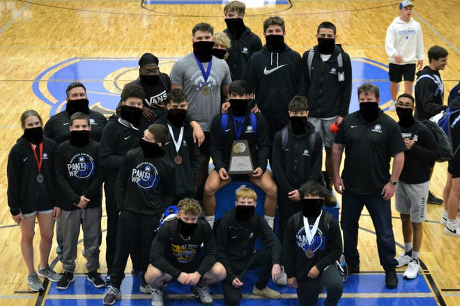 Midlothian High School wrestlers show off their winnings at the district championship meet in Burleson on April 5. The Panthers qualified a total of 10 boys and one girl for the regional meet this weekend.