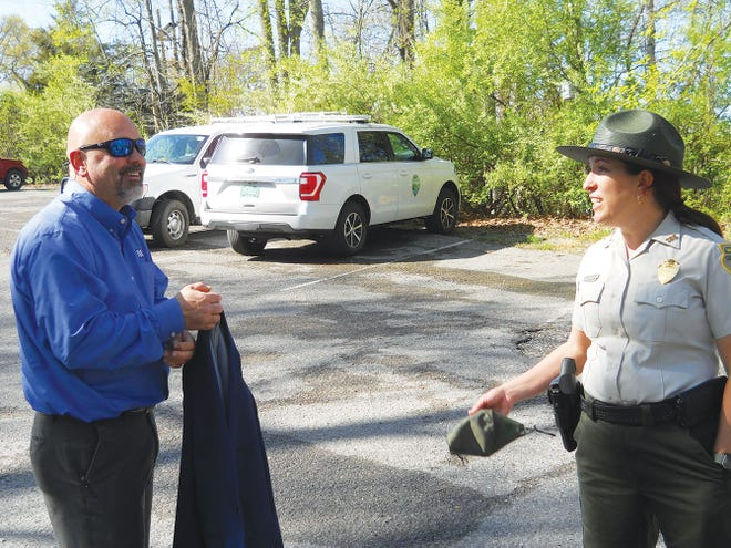 David Bowling, TVA vice president of River and Resource stewardship, talks to Norris Dam State Park Manager Veronica Greear.