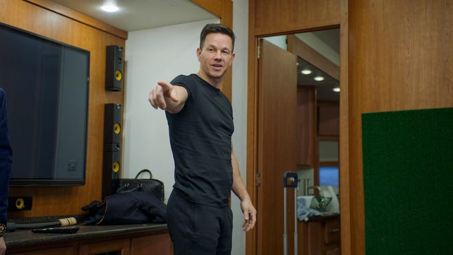 """Dorchester native Mark Wahlberg appears in a scene from HBO Max's """"Wahl Street,"""" the six-part docuseries that looks at the actor's entrepreneurship, including Hingham's burger chain, Wahlburgers."""