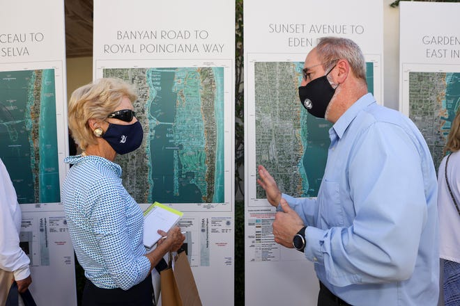 Town of Palm Beach civil engineer Craig Hauschild helps West Palm Beach resident Ann Tyler understand what she can do to keep her garage from flooding during a Flood Risk Workshop at the Preservation Foundation of Palm Beach on Friday.
