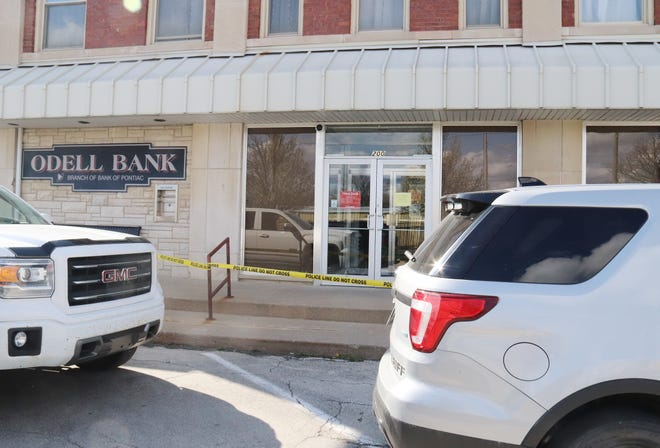The front entrance to the Odell Bank was cordoned off with police tape Friday afternoon. A suspect has been identified and is being sought in relation to the incident.