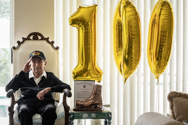 Lou Gregory, a Palm Beach Gardens resident for 27 years, turned 100 years old April 9. The World War II veteran is seen here in a portrait at his home.