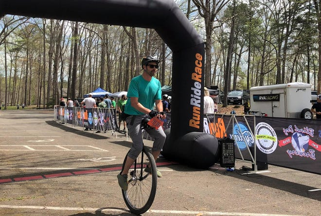 Russell McGee crosses the Monster Cross 2021 25-mile finish line taking third place in the unicycle division at Pocahontas State Park in Chesterfield, Va. on April 11.