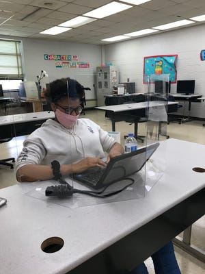 A Petersburg student sits at their desk, socially distanced with a mask and plexiglass shield. This was the first day students were allowed back for in-person instruction sine the beginning of the COVID-19 pandemic.