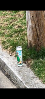 A votive candle placed on Atlantic Avenue on Monday afternoon as word spread that a young man had been shot to death.