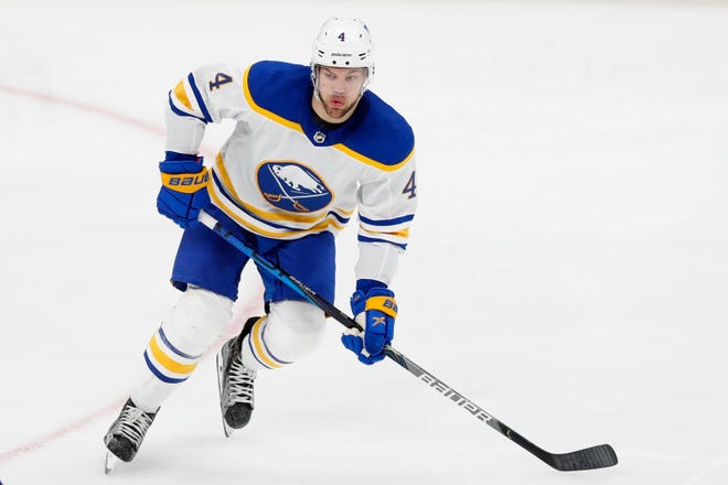 In this Saturday, March 27, 2021 file photo, Buffalo Sabres Taylor Hall plays against the Boston Bruins during the second period of a game in Boston. The Bruins acquired Hall, the NHL MVP in 2018, from the Sabres, Monday, for fourth-year forward Anders Bjork and a second-round pick.