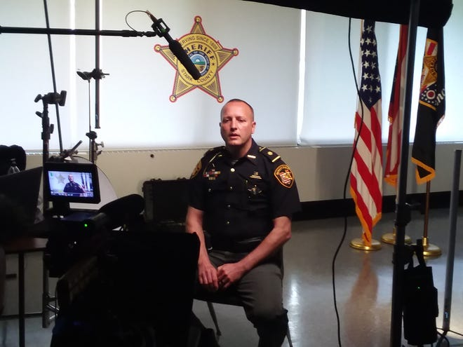 Major C.J. Stantz of the Stark County Sheriff's Office records his portion of a video being produced for law enforcement agencies about crisis-prevention programs offered by Stark County Mental Health & Addiction Recovery.