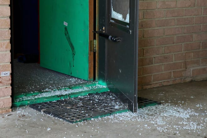 Broken glass in a screen door at a home in the 2100 block of Bellwort Drive in Winnebago County, where a man was fatally shot by a sheriff's deputy on Saturday.