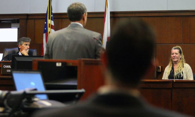 In this file photo from The Record, St. Johns County Judge Charles Tinlin listens as defense lawyer Patrick Canan, center, questions a witness during a trial in 2002.