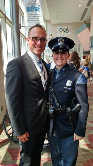 Michigan State Police Trooper Rachel Olesen pictured with her husband, Michael Olesen, who is the local Department of Natural Resources conservation officer for Chippewa County.