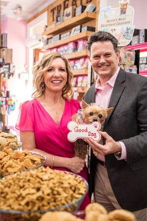 Michelle and David Pence with dog Lucy at Woof Gang Bakery & Grooming