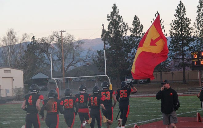 Members of the Yreka High football team take to the field at the start of Friday's home game.