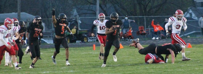 Melcon DeJesus (3) gets a timely block on his kickoff return for a touchdown