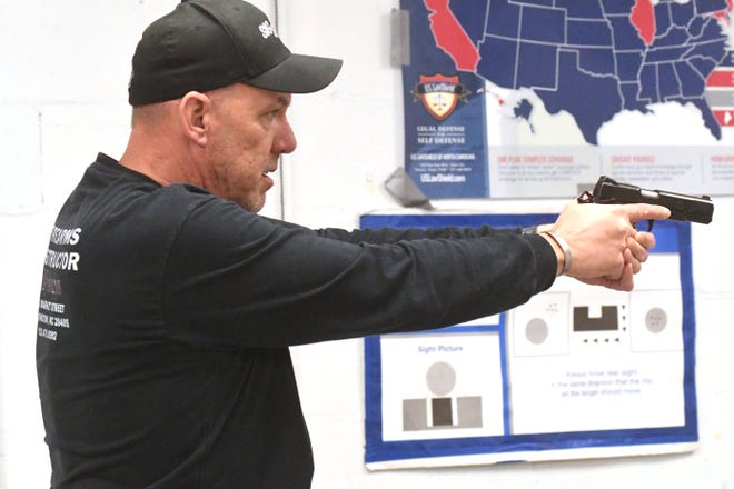 Firearms Instructor Tony Wisyanski teaches a concealed carry class Friday Sept. 11, 2020 at BullZeye Shooting Sports in Wilmington, N.C.  With a surge in gun sales this year, starting with COVID-19 and cresting after protests broke out many people have started taking concealed classes.