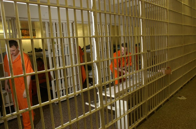 Inmates in a cell block at the New Hanover County jail.
