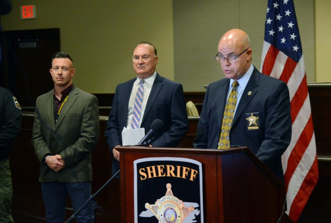 During a Monday, April 12 press conference, Craven County Sheriff Chip Hughes, right, discusses a months-long investigation targeting illegal drugs and firearms violations that led to more than 60 arrests and the seizure of approximately $33,000. [TODD WETHERINGTON / SUN JOURNAL STAFF]