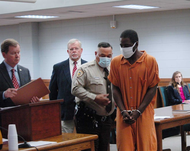Murder suspect Eric Daniel Lipford leaves his first Craven County court appearance Monday, remaining in jail without bond. [Charlie Hall / Sun journal]