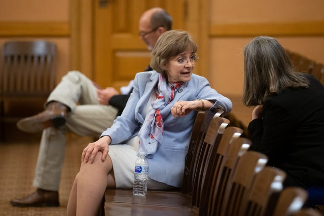 Kansas Sen. Beverly Gossage, R-Eudora, sits in on a Republican caucus meeting at the Statehouse. She had requested the bill extending the timeframe for short-term health insurance plans in Kansas to an allowed 3 years.