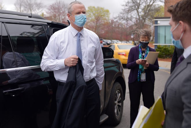 Gov. Charlie Baker arrives at the Family Health Center in Worcester on Monday.