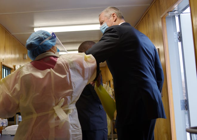 Gov. Charlie Baker greets a worker at the Family Health Center in Worcester on Monday.