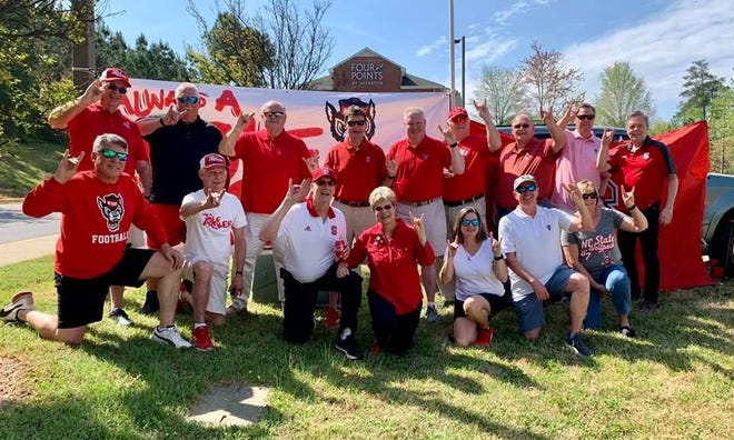"""A group of former N.C. State athletes formed the 'Always a Wolfpacker!"""" Facebook group in 2015 which has now has over 6,000 members. The community grew during the pandemic and members of the group met for the first time since 2019 to tailgate before the spring football game last weekend."""