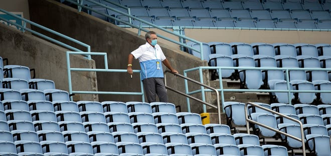 UNC athletic director Bubba Cunningham watches UNC football's home opener against Syracuse in an empty Kenan Stadium last September. As part of the NCAA Division I recruiting dead period, high school prospects could not take official visits to colleges for games or meet with coaches in person.