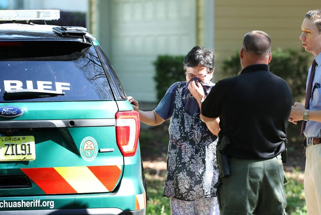 The mother of Jeremiah Arnold Lacsamana Birrey reacts after Birrey was shot by an Alachua County Sheriff's Office deputy early Monday morning in Gainesville. The Sheriff's Office reported that Birrey was shot while running toward his girlfriend with a knife, though his girlfriend said he did not try to stab her. [Brad McClenny/Gainesville Sun]