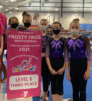 The Tusc YMCA optional gymnastics team placed third at the prestigious annual Frosty Frog YMCA Invitational in Wooster last Saturday. Coming in only five points behind Toledo and Wooster's Level 6 team scores, they also captured one trophy, 10 medals and 22 ribbons in individual awards. They are Avery Worst (left to right), Aubri Miller, Jaycie Baker, Landry Little, Riley Miller, Caycee Albaugh. Not in pictured was Heather Demuth, who was injured during the meet