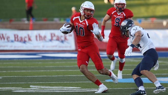 CSU Pueblo football wide receiver Nick Williams eludes a Colorado Mines defender during a 2019 game. The Thunderwolves are wrapping up some unusual spring practices without a spring game this week due to COVID-19 protocols.