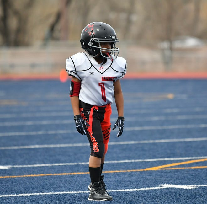 Emmanuel Wolfe lines up in the Pueblo Predators' matchup against the Colorado Springs Vikings Sunday, April 11, 2021 at Vanguard High School. The game was Wolfe's first since being told he was cancer-free.