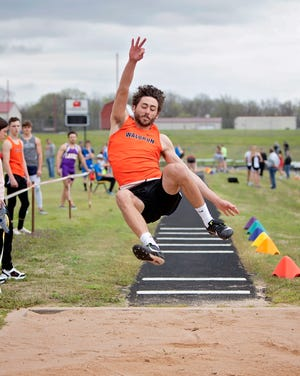 Waldron senior track standout Bryson Bailey competes in the long jump during a recent meet. Bailey set a personal record in the long jump at the Bulldogs' annual Gaile Hainley Relays on April 8, 2021.